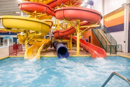 Indoor pool with water slide | Sleep Inn & Suites Conference Center and Water Park
