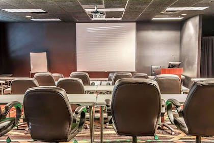 Meeting room with classroom-style setup | Sleep Inn & Suites Conference Center and Water Park