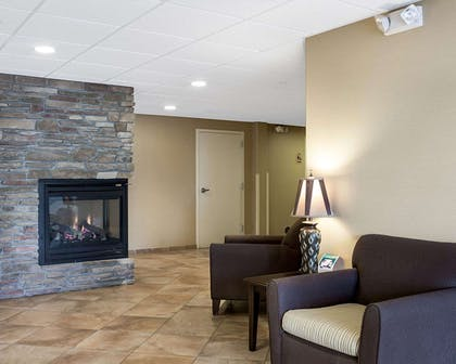 Relax by the fireplace in the lobby | Mainstay Suites