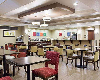 Enjoy breakfast in this spacious area | Comfort Suites Minot