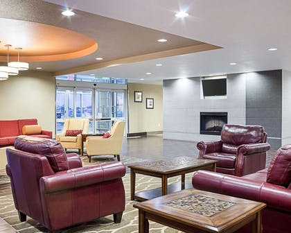 Lobby with fireplace | Comfort Suites Minot