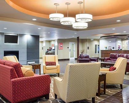 Spacious lobby with sitting area | Comfort Suites Minot
