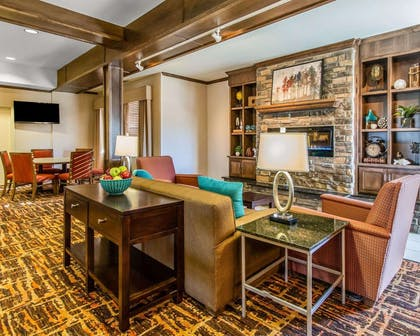 Spacious lobby with sitting area | MainStay Suites Event Center