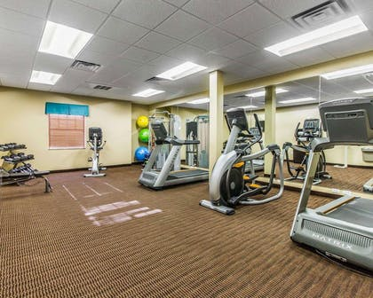 Fitness center with cardio equipment and weights | MainStay Suites Event Center