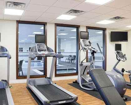 Exercise room with cardio equipment and weights | Comfort Suites Medical Center