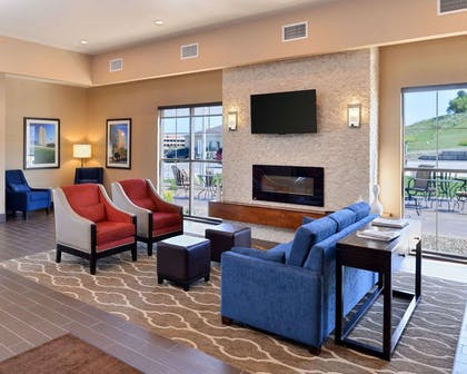 Relax by the fireplace in the lobby   Comfort Inn & Suites Mandan - Bismarck