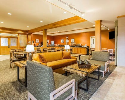 Enjoy breakfast in this seating area | MainStay Suites Stanley
