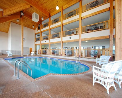 Indoor pool with hot tub | Norfolk Lodge & Suites, an Ascend Hotel Collection Member