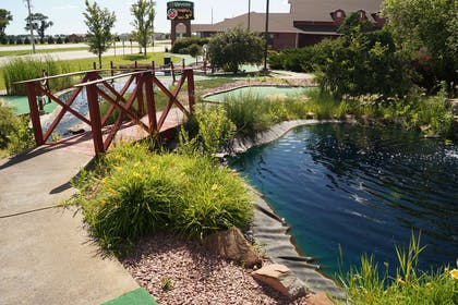 Enjoy a round of mini-golf | Norfolk Lodge & Suites, an Ascend Hotel Collection Member