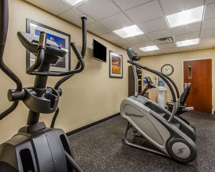 Fitness center with television | MainStay Suites