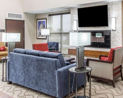Lobby with fireplace | Comfort Suites West Omaha