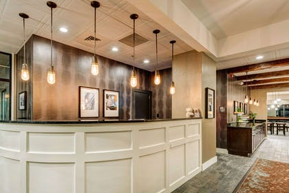 Front desk with friendly staff | The Garrison Hotel & Suites Dover-Durham, Ascend Collection