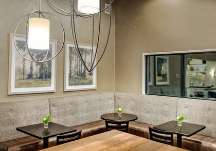 Enjoy breakfast in this seating area | The Garrison Hotel & Suites Dover-Durham, Ascend Collection