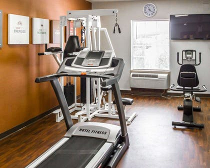 Fitness center with television | Quality Suites NYC Gateway