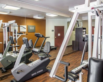 Fitness center with cardio equipment and weights | Quality Suites NYC Gateway