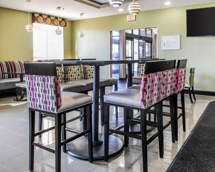 Enjoy breakfast in this seating area | Comfort Inn & Suites Artesia