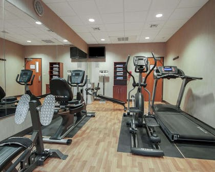 Exercise room with cardio equipment and weights | MainStay Suites