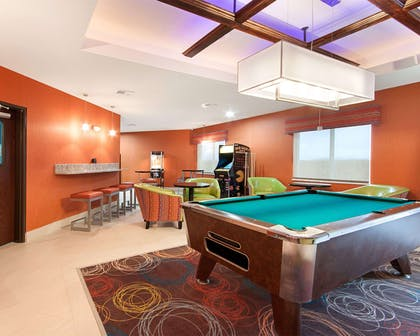 Game room with pool tables | MainStay Suites