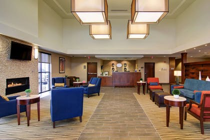 Spacious lobby with sitting area | Comfort Suites Carlsbad