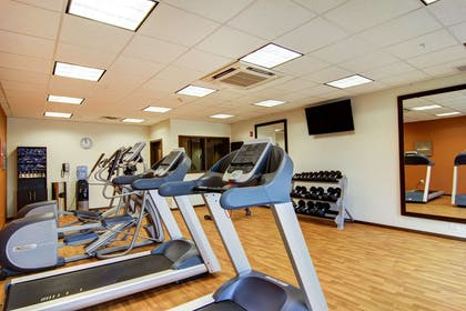 Fitness center with cardio equipment and weights | Comfort Suites Carlsbad