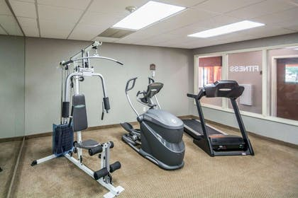 Exercise room with cardio equipment and weights | Comfort Inn Corning