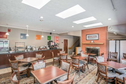 Enjoy breakfast in this seating area | Comfort Inn Corning