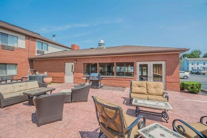 Relax on the hotel patio | Comfort Inn Corning