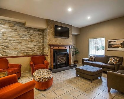 Lobby with fireplace | Quality Inn & Suites Fishkill South near I-84