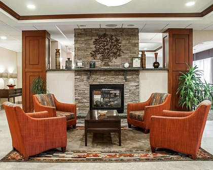 Relax by the fireplace in the lobby   Comfort Inn & Suites Watertown - 1000 Islands