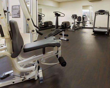 Fitness center with cardio equipment and weights | Comfort Inn & Suites Airport