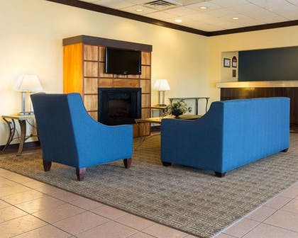 Lobby with fireplace | Comfort Inn & Suites Airport