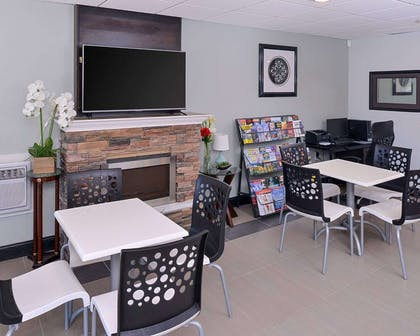 Enjoy breakfast in this seating area | Econo Lodge Rochester I-90 & I-390