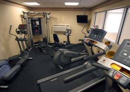 Fitness center with cardio equipment and weights | Comfort Inn & Suites