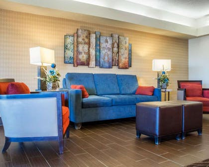 Spacious lobby with sitting area | Comfort Inn Rochester - Greece