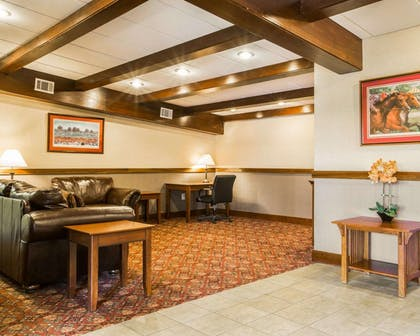 Spacious lobby with sitting area | Clarion Inn & Suites at the Outlets of Lake George