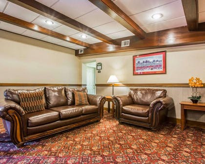 Lobby with sitting area | Clarion Inn & Suites at the Outlets of Lake George