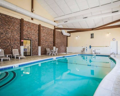 Indoor pool with sitting area | Clarion Inn & Suites at the Outlets of Lake George