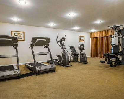 Fitness center with cardio equipment and weights | Clarion Inn & Suites at the Outlets of Lake George