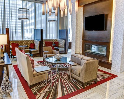 Spacious lobby with sitting area | Cambria Hotel White Plains - Downtown