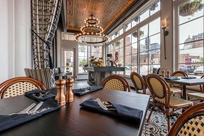 Enjoy breakfast in this seating area | Curtiss Hotel, An Ascend Hotel Collection Member