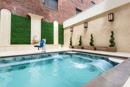 Relax by the pool | Curtiss Hotel, An Ascend Hotel Collection Member