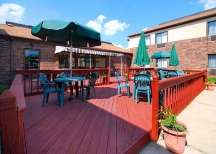 Relax on the hotel patio | Comfort Inn East