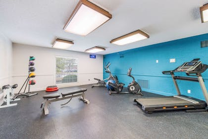 Exercise room with cardio equipment and weights | The Blu Hotel, an Ascend Hotel Collection Member