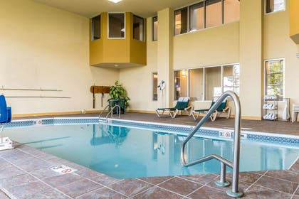 Relax by the pool | Comfort Suites