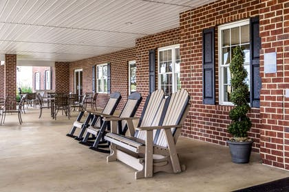 Relax on the front porch | Comfort Suites Hotel and Conference Center