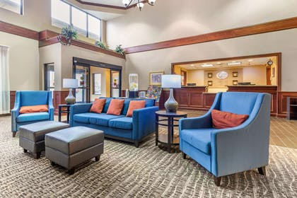 Spacious lobby with sitting area | Comfort Suites Findlay I-75