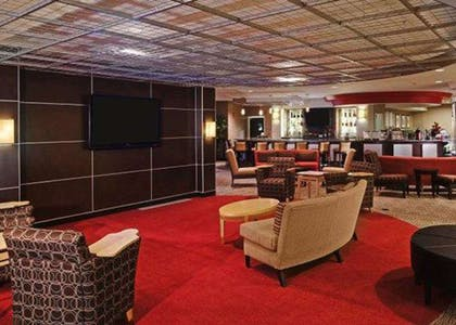 Catch up on the day in front of the large-screen media wall | Cambria Hotel Columbus - Polaris