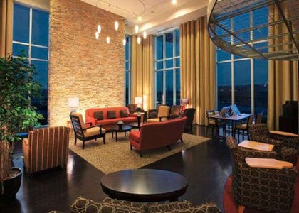 Relax in the open space lobby with club-lounge seating | Cambria Hotel Columbus - Polaris