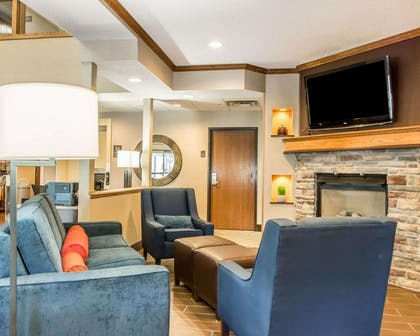 Relax by the fireplace in the lobby | Comfort Inn North/Polaris