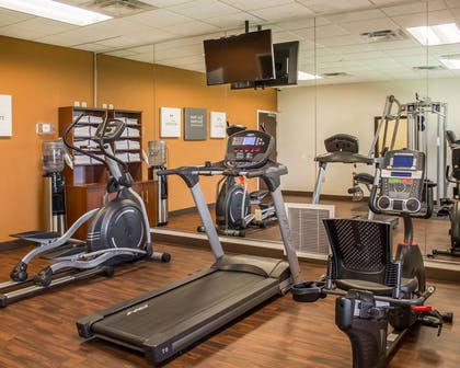Fitness center with cardio equipment and weights | Comfort Suites East Broad at 270